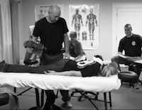 Kyle Treating Client at Table-side - Your Clinical, Medical Massage Therapy Career
