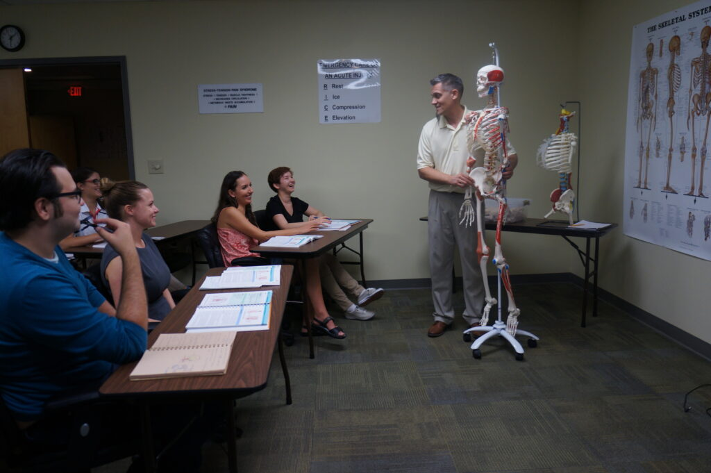 Sean instructing class in anatomy & physiology for medical massage therapy & myo-structural bodywork